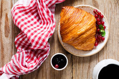 Continental breakfast with croissant, jam and coffee Royalty Free Stock Image