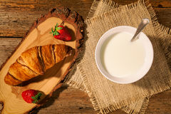 Continental breakfast with croissant, strawberries and a cup of Royalty Free Stock Photos