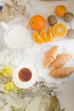Continental breakfast with gold french croissants fruits and cup Royalty Free Stock Images