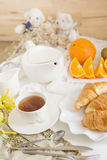Continental breakfast with gold french croissants fruits and cup Royalty Free Stock Photography