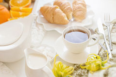 Continental breakfast with gold french croissants fruits and cup Stock Photo