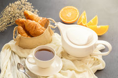 Continental breakfast with gold french croissants fruits and cup Stock Photography