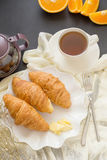 Continental breakfast with gold french croissants fruits and cup Stock Photos