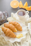 Continental breakfast with gold french croissants fruits and cup Stock Image