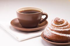 Continental Breakfast with Hot Tea and Sweet Bun Royalty Free Stock Image