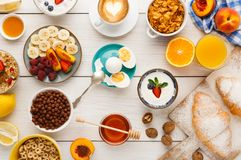 Continental breakfast menu on woden table. Rich continental breakfast menu background. Delicious natural food for tasty morning meals on wooden table royalty free stock photos