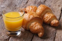 Continental breakfast: orange juice and croissants Royalty Free Stock Images
