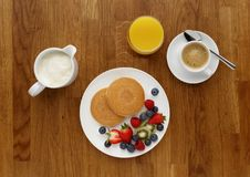 Continental breakfast of a Pancakes, fruit, orange juice, and co royalty free stock photography
