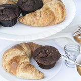 Continental breakfast table setting with pastries and cakes Royalty Free Stock Photography