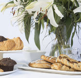 Continental breakfast table setting with pastries and cakes Royalty Free Stock Images