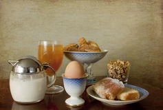 Continental breakfast,waiting for the coffee. Good morning with an healthy and delicious continental breakfast: muesli and milk, boiled egg, lemon cake ,Italian stock image