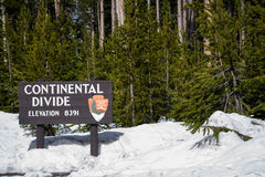 Continental divide sign on mountain in snow - Yellowstone Nation Stock Photos