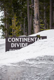 Continental divide sign on mountain in snow - Yellowstone Nation. Travel vacation tourism photos taken in Yellowstone National Park Wyoming USA. continental Stock Photos