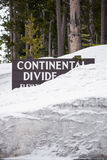 Continental divide sign on mountain in snow - Yellowstone Nation. Travel vacation tourism photos taken in Yellowstone National Park Wyoming USA. continental Stock Photo