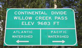 Continental Divide sign. Sign for the Continental Divide and the Pacific and Atlantic Watersheds at Willow Creek Pass on the county line between Jackson County stock images