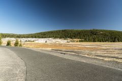 Continental Divide Trail beside Old Faithful. Near the famous geyser attraction in Yellowstone known for its hot-water eruptions on a consistent schedule stock photos