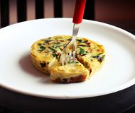 Continental omlette on white plate royalty free stock images