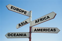 5 continents of the world on a sign post Royalty Free Stock Image
