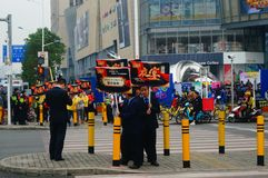 A contingent of billboards on the streets of Shenzhen. The shopping mall carries out a big sale of goods, and the staff of the market hold the billboard in the Stock Photography
