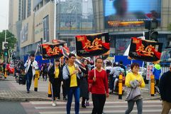 A contingent of billboards on the streets of Shenzhen. The shopping mall carries out a big sale of goods, and the staff of the market hold the billboard in the Royalty Free Stock Images