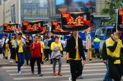 A contingent of billboards on the streets of Shenzhen. The shopping mall carries out a big sale of goods, and the staff of the market hold the billboard in the Royalty Free Stock Photos