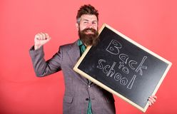 Continue education private school. Teacher begin first lesson after holidays. School and studying concept. Teacher or. Educator welcomes students while holds royalty free stock photos