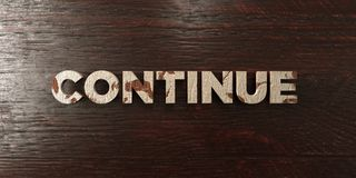 Continue - grungy wooden headline on Maple  - 3D rendered royalty free stock image Royalty Free Stock Photography