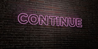 CONTINUE -Realistic Neon Sign on Brick Wall background - 3D rendered royalty free stock image Royalty Free Stock Image