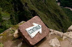 Continue sign. The picture of the continue sign in mountains Stock Image