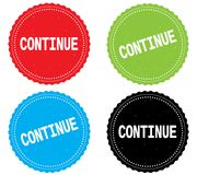 CONTINUE text, on round wavy border stamp badge. Royalty Free Stock Photos