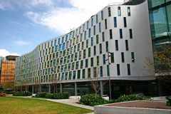 Continuous and undulating gray facade of Vicki Sara Building with array of rectangular windows at University Technology Sydney UTS. Continued and cured royalty free stock photo