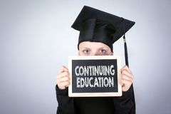 Continuing Education. Boy with a Chalkboard in hands Royalty Free Stock Image
