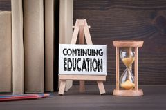 Free Continuing Education Concept. Sandglass, Hourglass Or Egg Timer On Wooden Table Royalty Free Stock Photo - 104252615