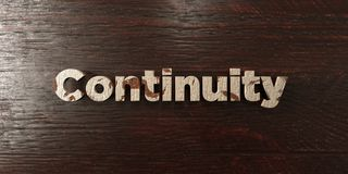 Continuity - grungy wooden headline on Maple  - 3D rendered royalty free stock image Stock Images