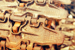 Continuous caterpillar tracks of the bulldozer. Close up. detail of a rusty tractor tracks. Continuous caterpillar tracks of the bulldozer. Close up. detail of Royalty Free Stock Photo