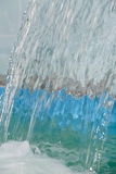 A continuous flow of water flows in the pool Royalty Free Stock Images