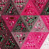 Continuous geometric pattern. The grenadine triangles, large colored geometric shapes. Geometric pattern. The grenadine triangles, large colored geometric shapes royalty free stock photography