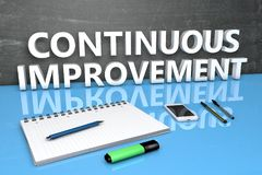 Continuous Improvement text concept. Continuous Improvement - text concept with chalkboard, notebook, pens and mobile phone. 3D render illustration Stock Photography