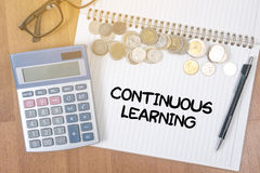 CONTINUOUS LEARNING. A finance Money, calculator notes, calculator top view with work stock photography