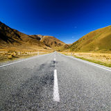 Continuous Road in a Scenic Mountain Concept Stock Image