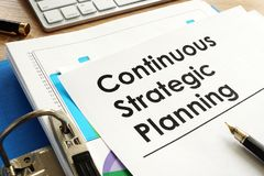 Continuous Strategic Planning on a table. Royalty Free Stock Photography