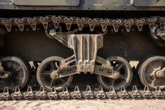 Continuous track from a tank. Continuous track from a green military tank of the World War II stock photo