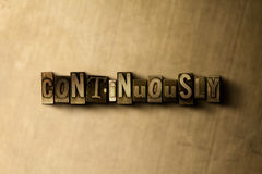 CONTINUOUSLY - close-up of grungy vintage typeset word on metal backdrop Stock Image