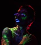 Contorno de la luz roja en la mujer sensual con Foto de archivo