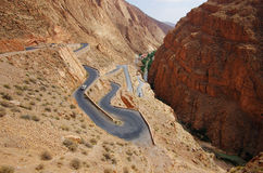 Contorted road. Climbing up a steep arid gorge stock images