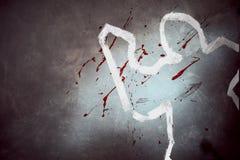 Contour blanc de victime à la scène du crime photographie stock libre de droits