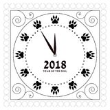 The contour of the dial of the watch with traces of the dog`s paws instead of figures. Map. Happy New Year. Contour pattern clock face with traces of dog`s paws Royalty Free Stock Images