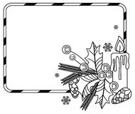 Contour frame with holly berry, pine cones, lighting candle and Christmas bells. Royalty Free Stock Photography