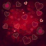 Contour hearts on dark red background Royalty Free Stock Photo
