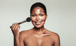 Contour and highlight makeup on female model face Stock Photo